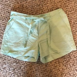 Lime green linen shorts with belt